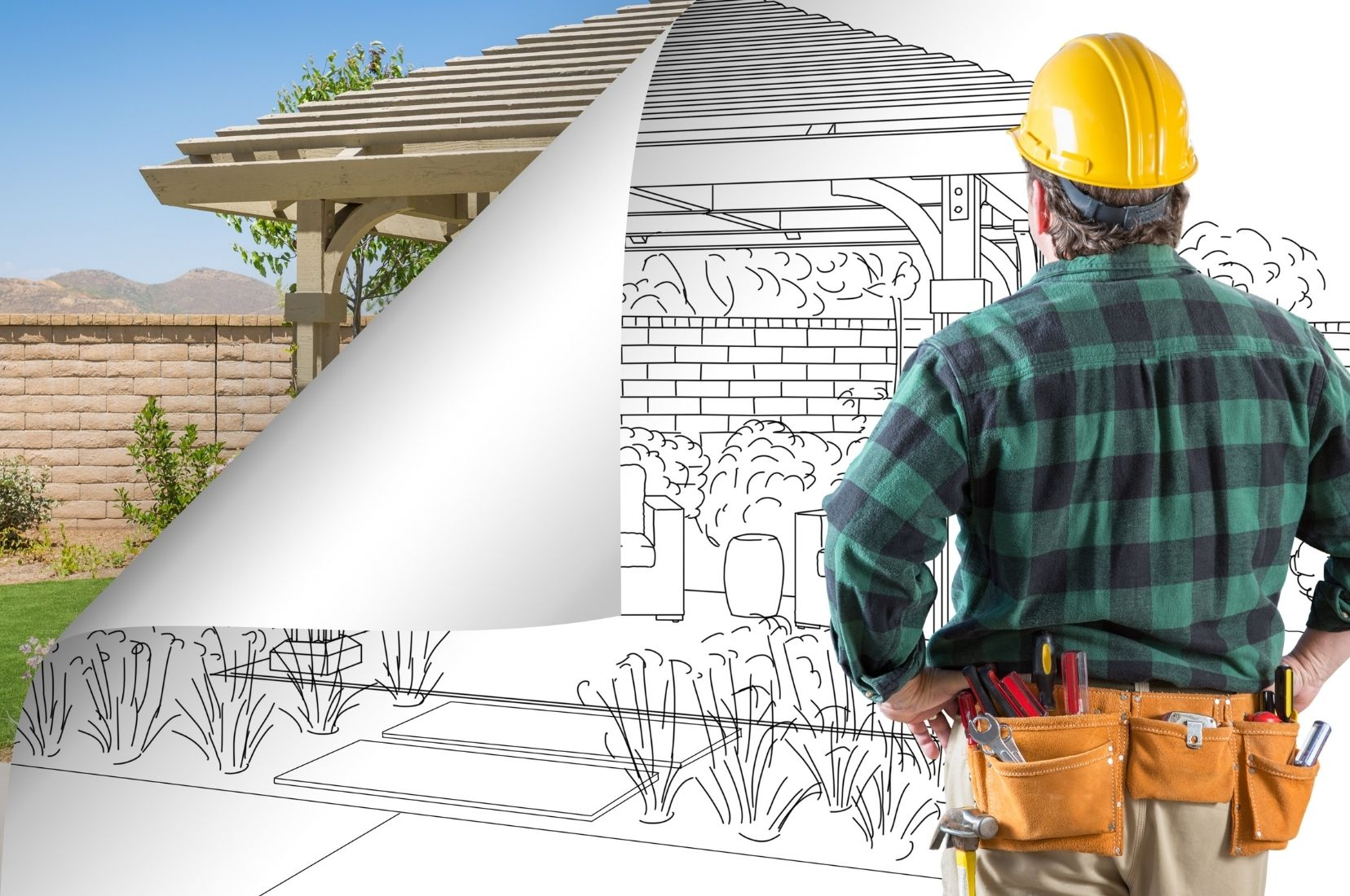 a Hobart Carports architect looking at his blueprint for a project